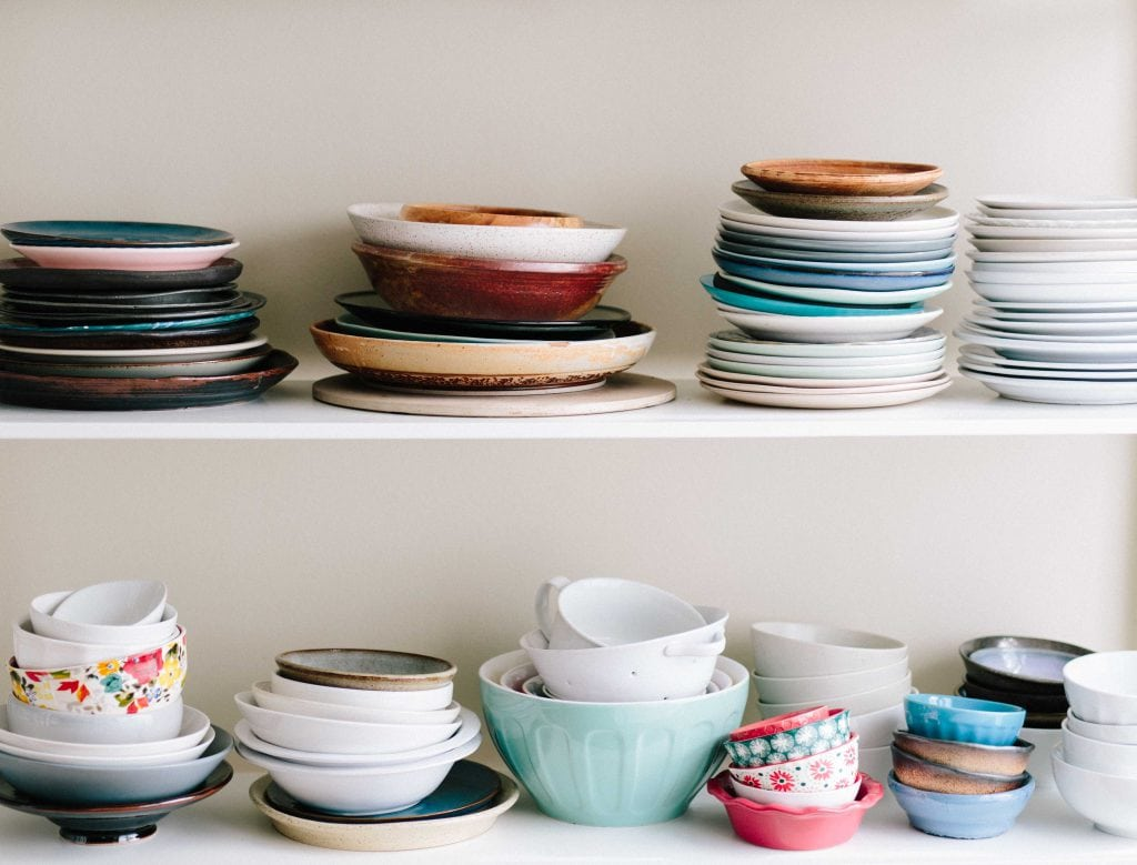 open shelves colorful plates bowls stacked
