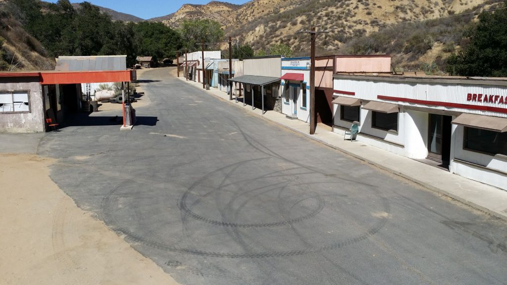 street front with tire marks on road in diamond v ranch