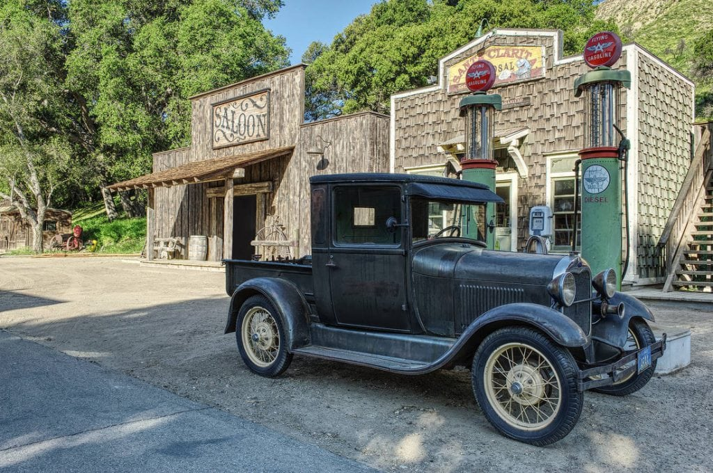 vintage car in front of saloon at rancho deluxe