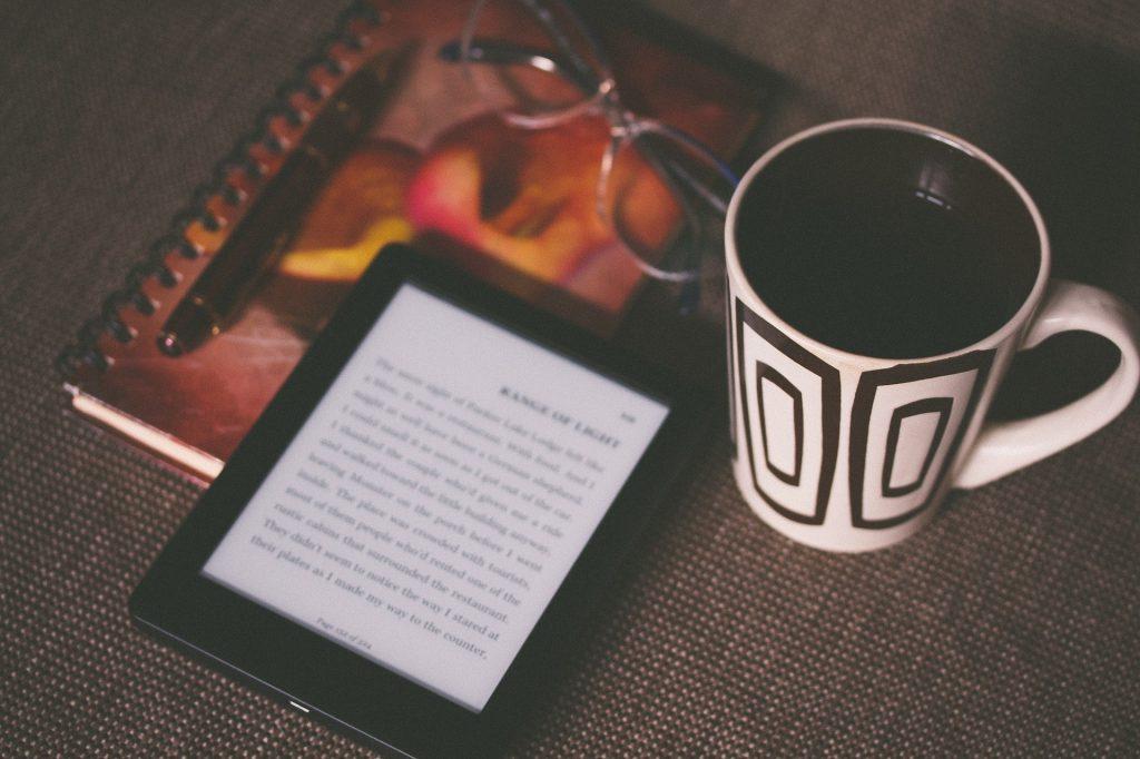 amazon kindle and coffee mug