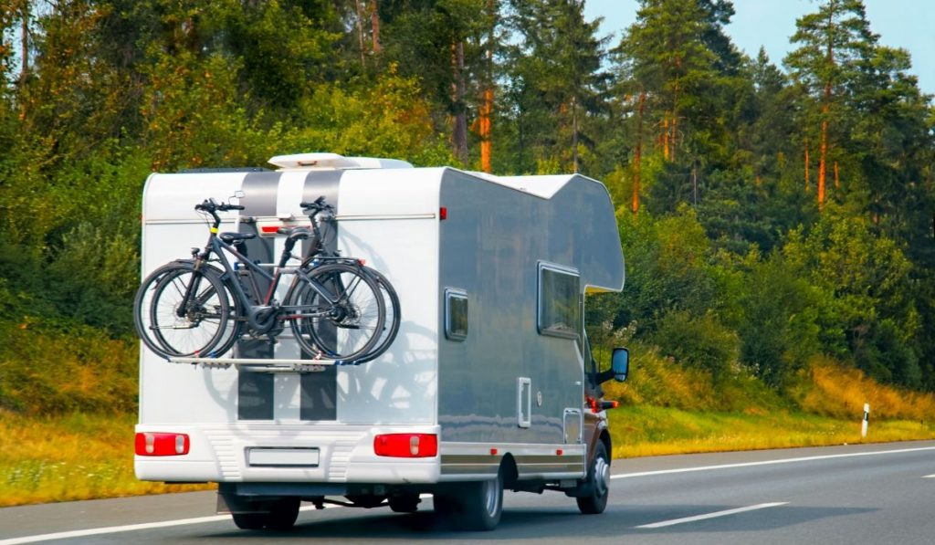 RV trailer on the road looking for an outdoor trailer storage facility.