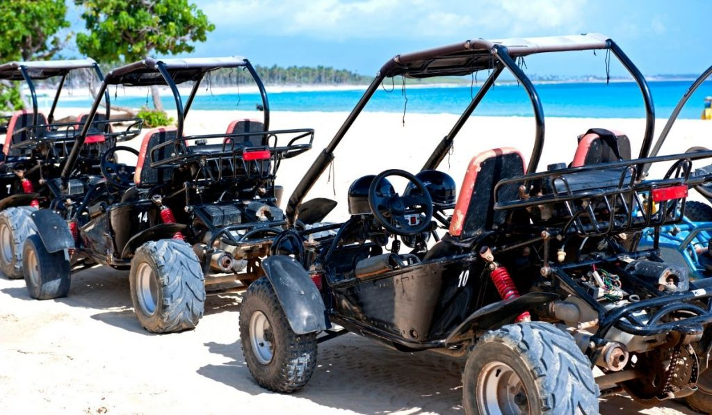 dune buggies parked on the beach