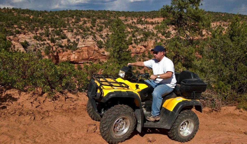 man on ATV exploring the summit