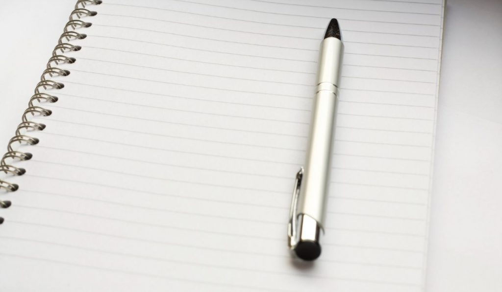 pen and paper for making a shopping list